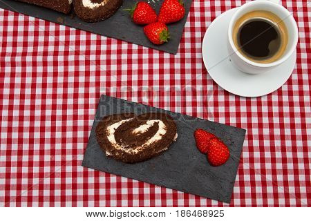 Choclater swiss roll A choclate swiss roll decorated with fresh strawberries