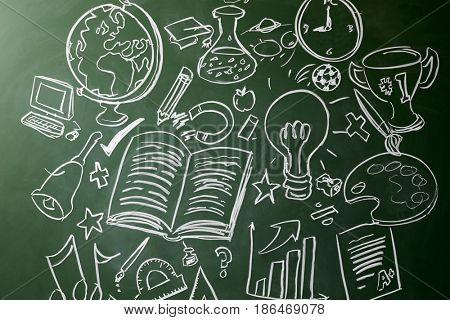 Hand drawn symbols of school subjects on a chalkboard