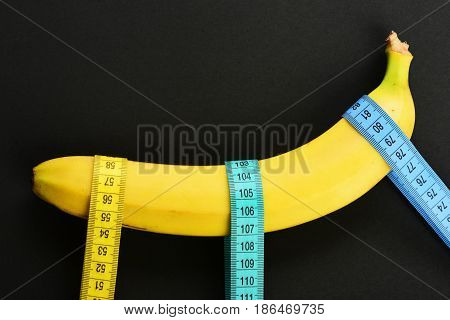 Tapes For Measuring Of Blue And Yellow Colors Holding Banana