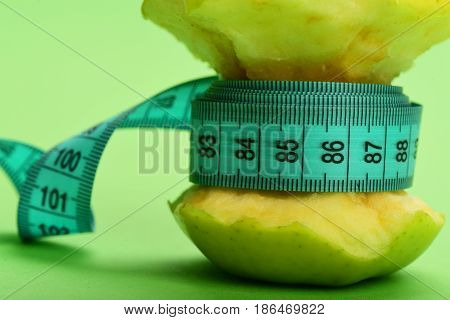 Apple Bitten And Wrapped By Measure Tape