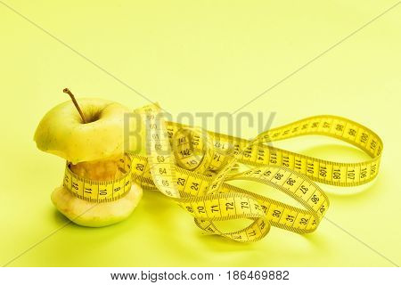Apple Wrapped By Yellow Measure Tape