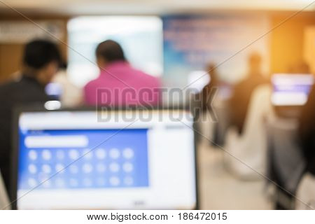 Abstract blurred of people lecture in computer seminar room education or training concept