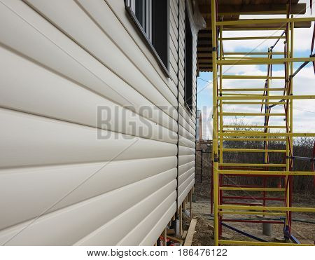 Repaired Rural House, Fixed Facade, Waterproofing Wood House By The Vinyl Plasting Siding