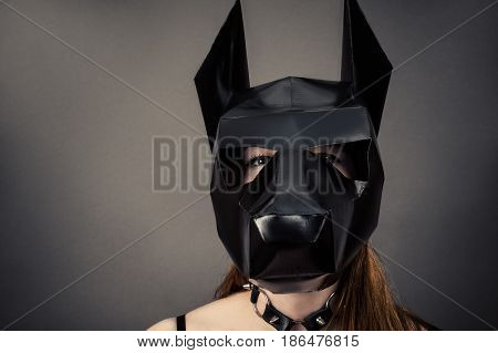 slave woman in dog mask isolated on gray background