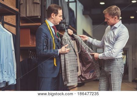 Businessman and tailor with a suit