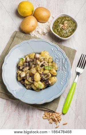 gnocchi with pesto sauce and octopus