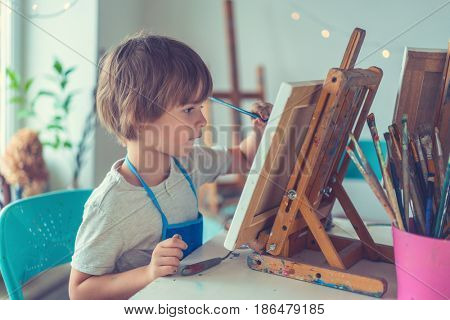 Little boy with an easel
