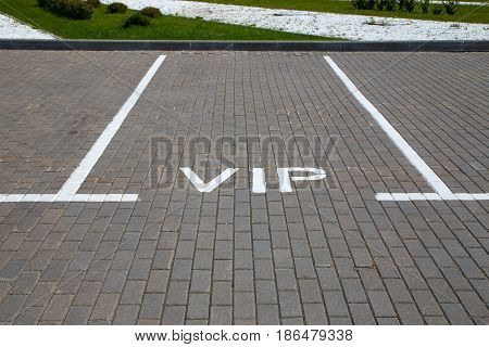 Empty parking space for a car with the word VIP