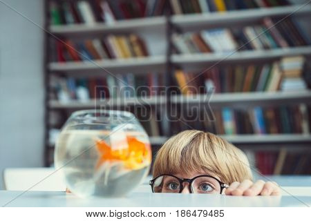 Little boy with aquarium