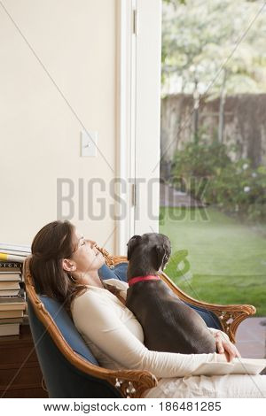 Caucasian woman sitting with dog