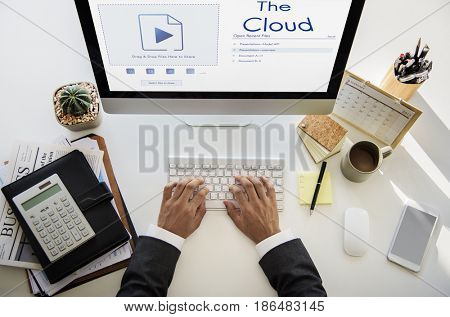 Hands sharing uploading a file to cloud storage