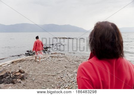 Caucasian woman on shore of lake