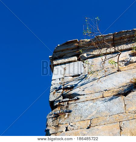 Old Towert And Marble Brick In Europe Athens Acropolis And Sky