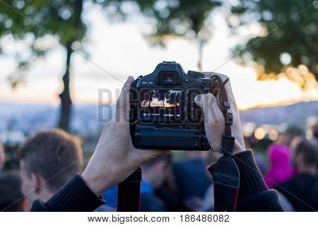 photographer taking photo of group of people