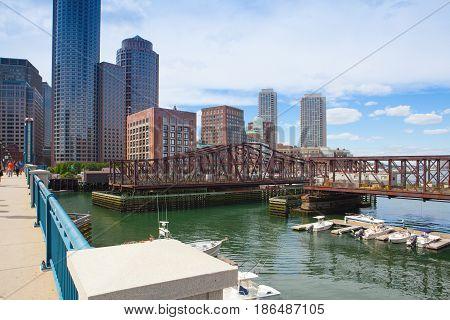 Boston Massachsetts USA - July 2 2016: Boston skyline from Seaport boulevard bridge.