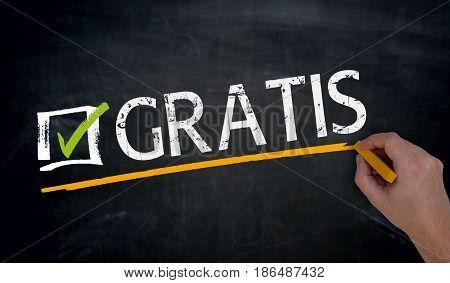 Gratis (in German Free) Is Written By Hand On Blackboard
