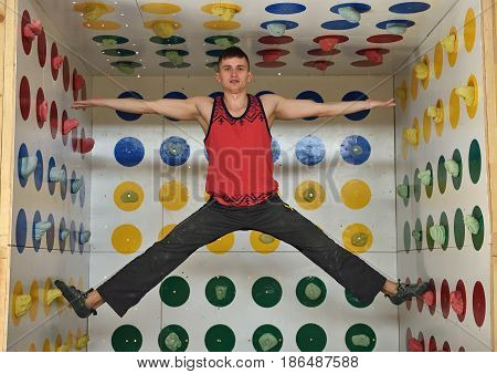 Man Playing In Climber Twister