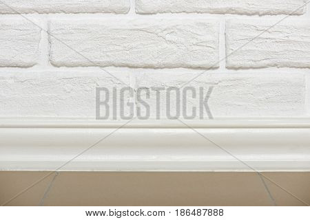 white brick wall with tiled floor closeup photo, abstract background photo