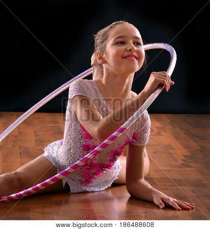 Rhythmic gymnastic girl using a gymnastic ring.