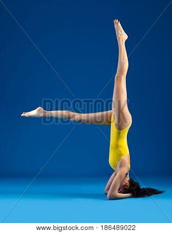 Young Woman Doing Yoga Asana Supported Headstand Salamba Sirsasana