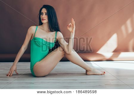 Young Woman Doing Yoga Asana Half Lord Of The Fishes Pose