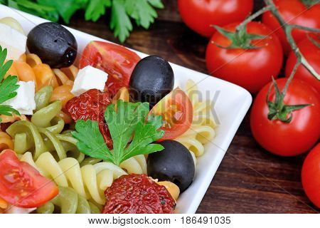 Colorful pasta with vegetable in a plate on table