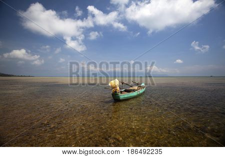 Wooden boat on tropical carribean beach