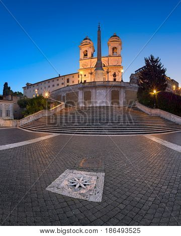 ROME ITALY - NOVEMBER 1 2013: Spanish Steps and Trinita del Monti Church in Rome. The monumental stairway of 135 steps was built with French diplomat Étienne Gueffier's funds.