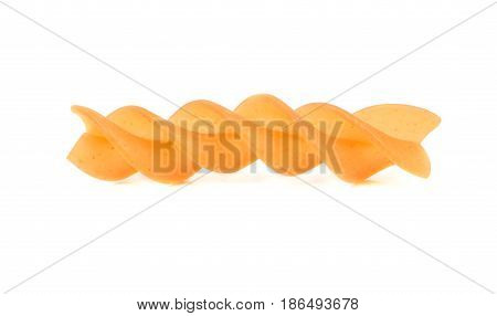 Raw carrot pasta fusilli isolated on white background