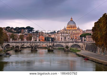 Tiber River and Saint Peter Cathedral in the Evening Rome Italy