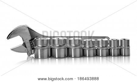 Set of hand sockets and screw wrench on white background