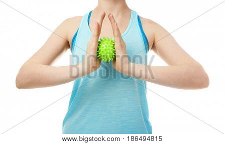 Woman doing exercises with rubber ball on white background
