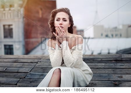 Beautiful Girl Sad Sitting On The Roof. Lonely Woman In Depressive Mood On The Roof.