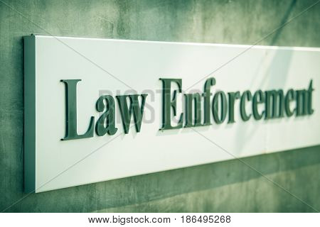 Word Law enforcement on label isolated decorate on wall in cinematic tone