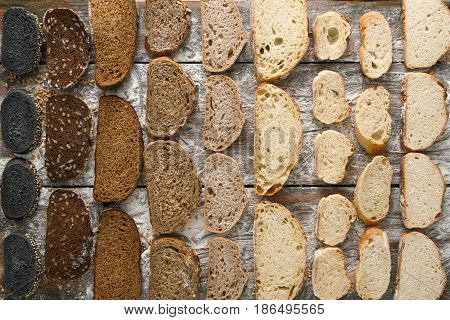 Sliced sorts of bread gradient pattern background. Bakery and grocery concept. Black, rye and white loaves