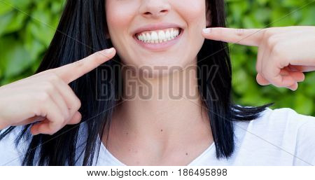 Brunette woman showing her perfect teeth