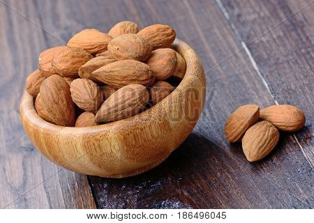 Almonds in a bamboo bowl on table