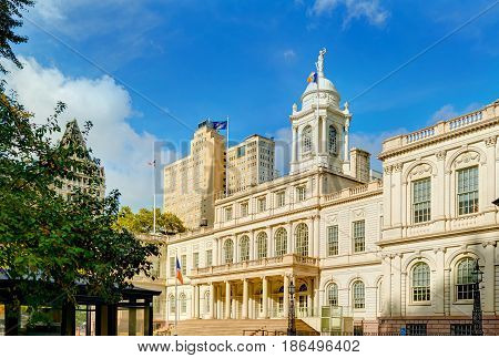 View on New York city NYC City Hall building and city park from Wall street and Nassau street, Brooklyn Bridge side. Old antique American architecture. Best famous USA holidays vacations tours