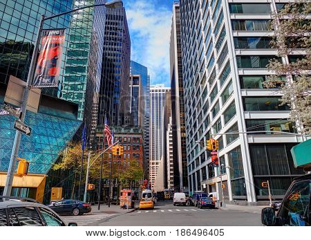 NEW YORK CITY, MANHATTAN, APRIL 24, 2015: Front street view on classical NYC office buildings and skyscrapers architecture. NYC architecture sightseeing holidays vacation tours trips travels