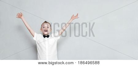 Cheerful Kid With Hands Up