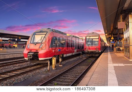 High Speed Red Commuter Trains On Railway Station