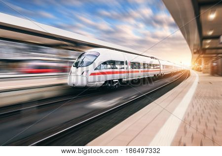 White Modern High Speed Train In Motion