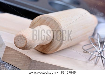 Kitchen tools on wooden table close up