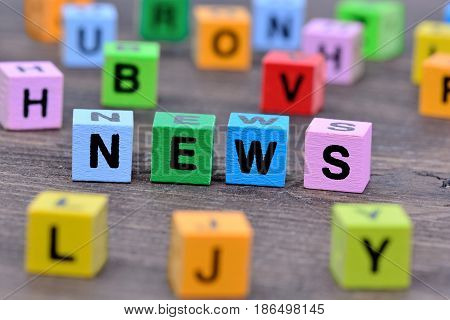 The word News on wooden table close-up