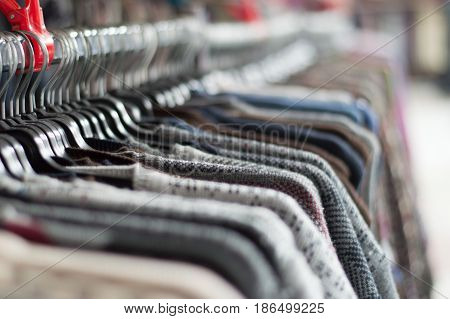 Closeup Of Assortment Of Warm Casual Clothing Hanging On Hanger