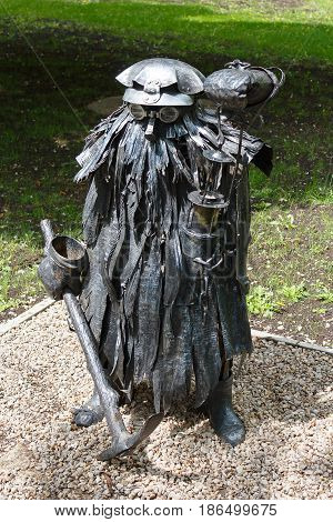 Donetsk Ukraine - May 09 2017: Iron sculpture of a mine ghost in the park of forged figures