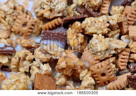 Muesli with biscuit and chocolate close up