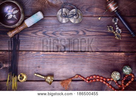 Tibetan musical instruments for meditation and relaxation singing bowl rosary prayer wheel bell and drum plates the empty space in the middle