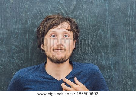 Top View Of A Young Man With Space For Text And Symbols On The Old Wooden Background. Concept For Co