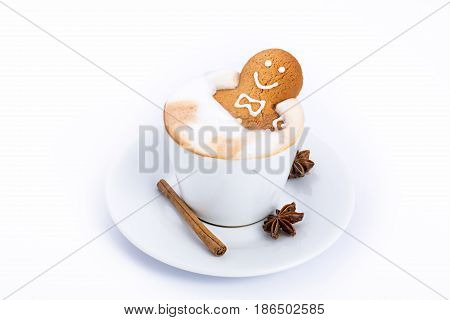 Gingerbread man inside coffee cup isolated on white.